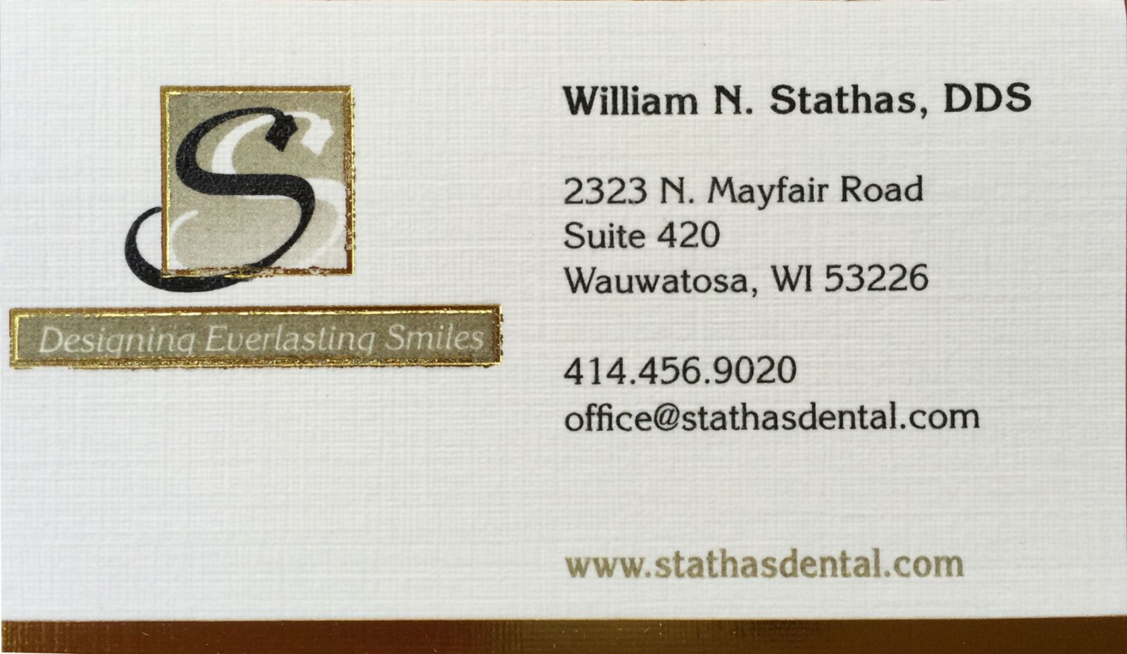 A business card of a dentist in Wauwatosa, WI